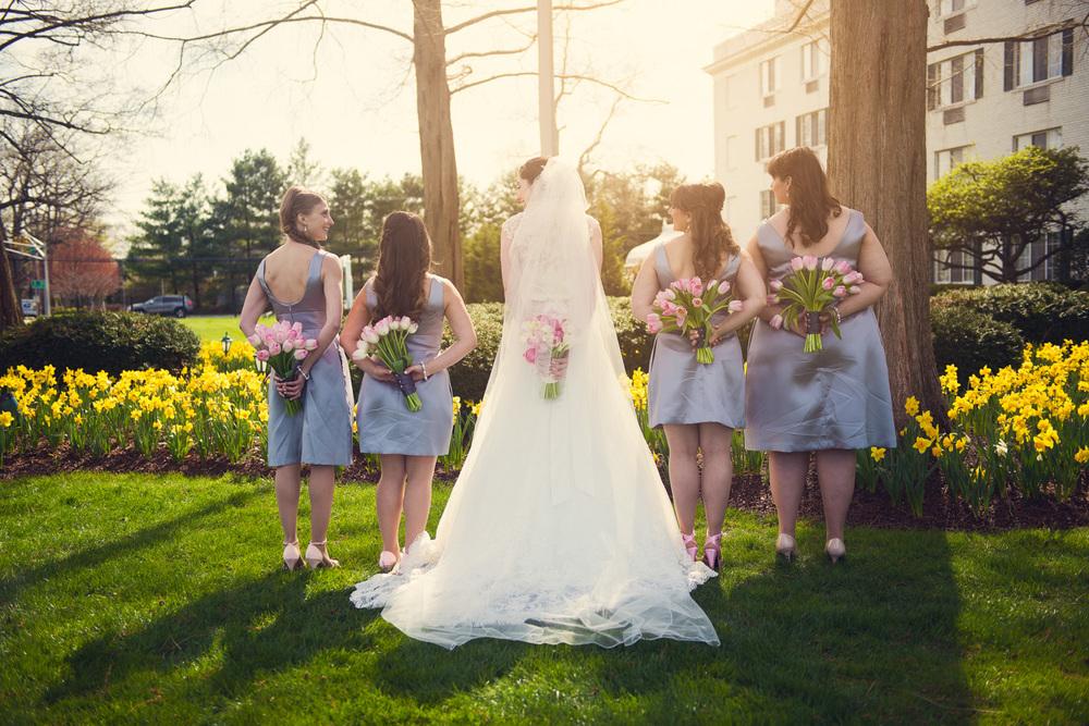 bride bridesmaids flowers back bouquets