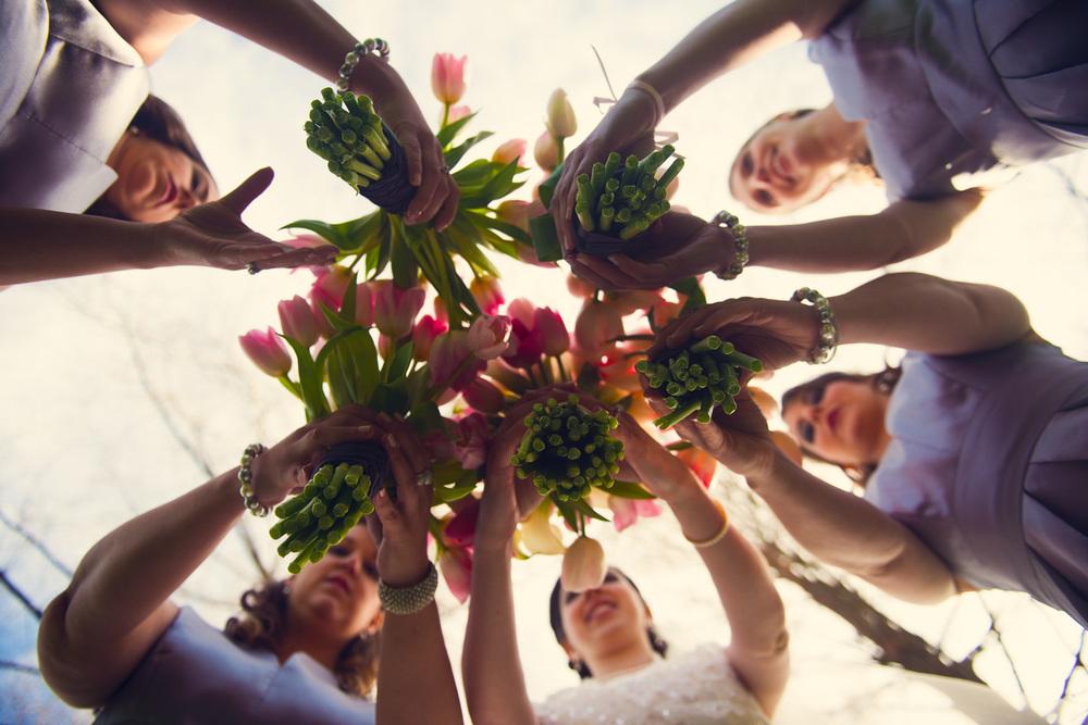 bride beneath artistic below bridesmaids flowers bouquets