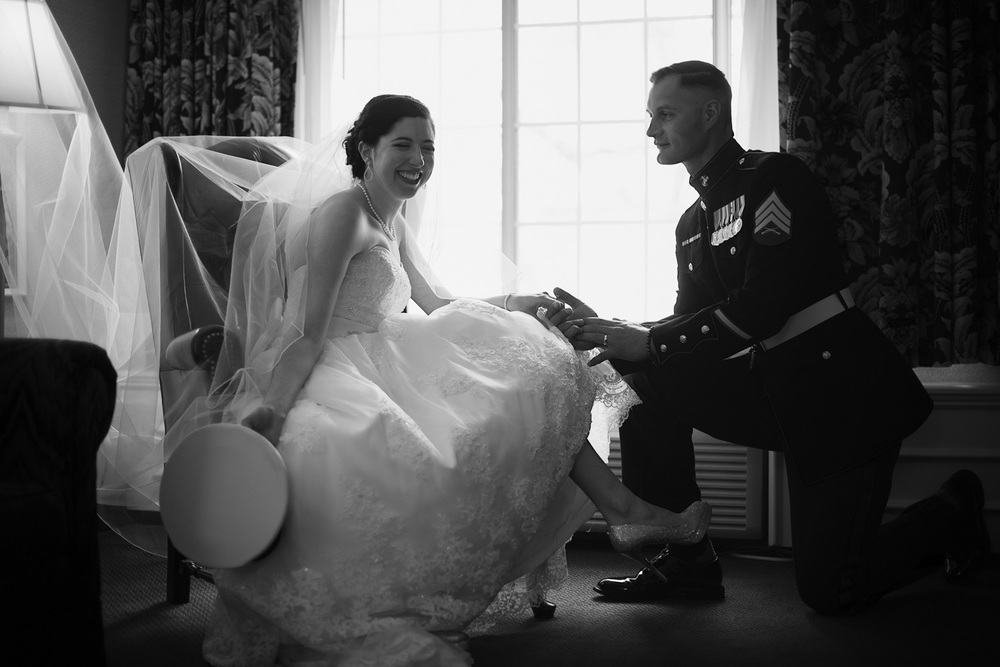 bride smiling groom kneeling marine husband wife window light portrait THPHOTO