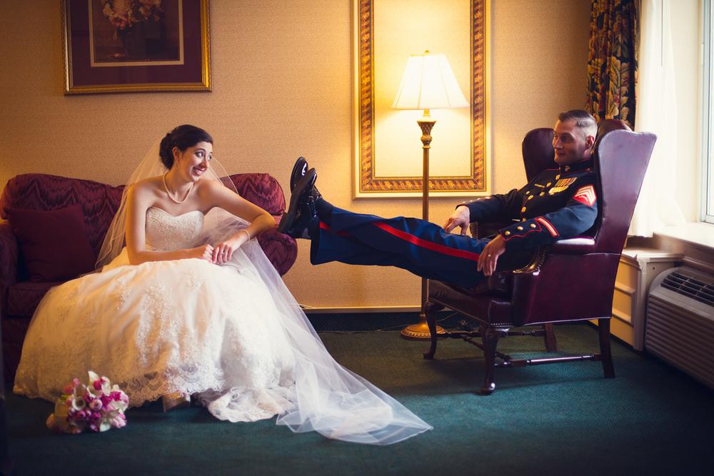 bride smiling groom feet up marine husband wife window light portrait THPHOTO