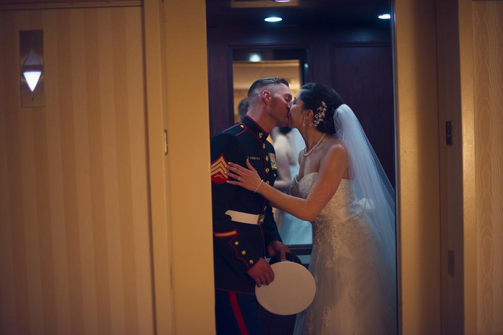 bride groom marine kissing elevator doors husband wife portrait THPHOTO