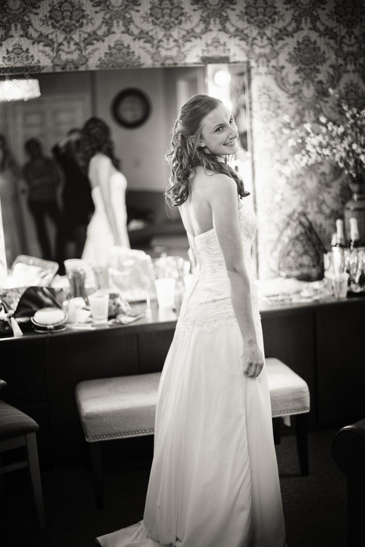 bride smiling mirror bw portrait THPHOTO