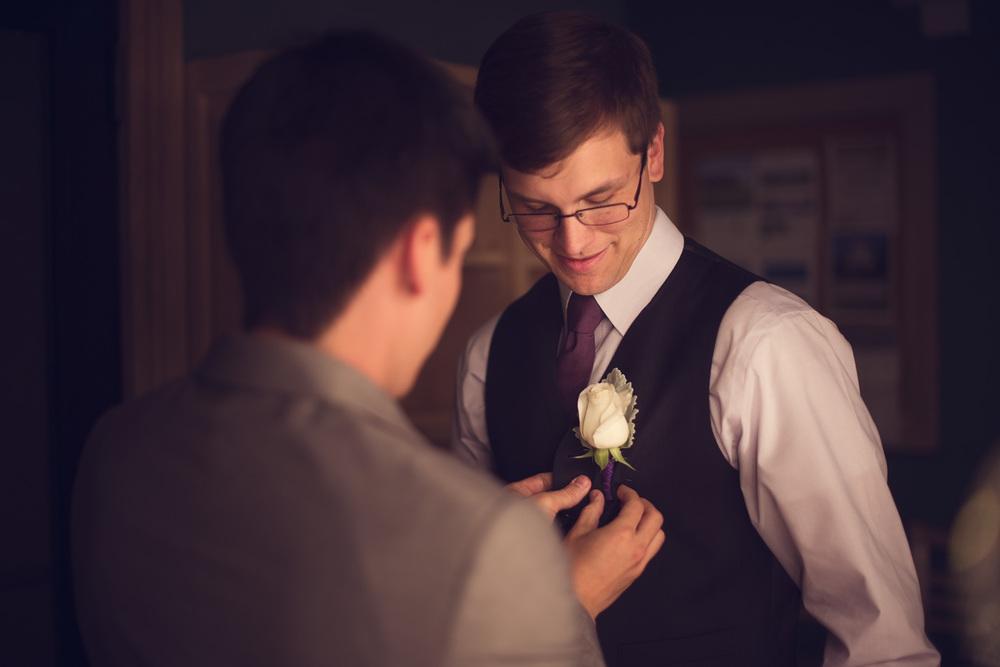 groom best man boutineer getting ready