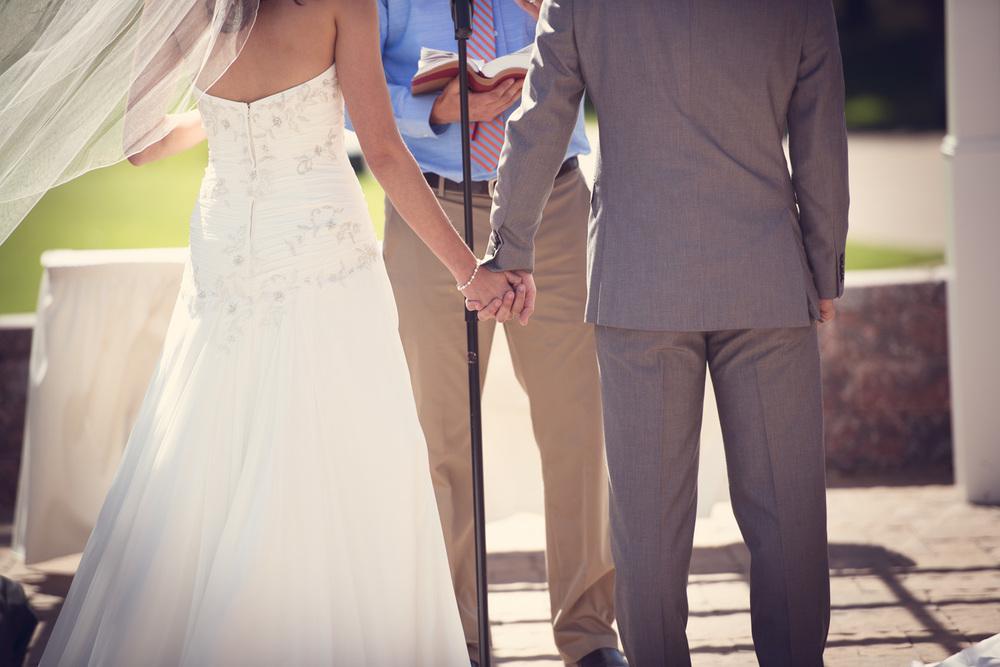 wedding bride groom holding hands daytime outdoors