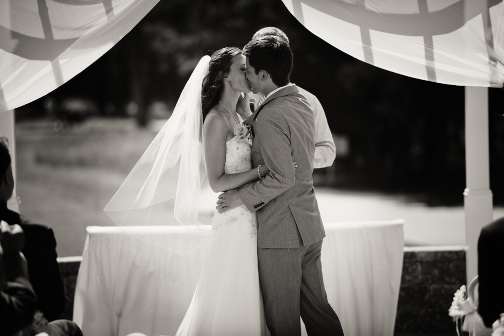 groom bride sunshine daytime wedding ceremony first kiss husband wife bw portrait THPHOTO