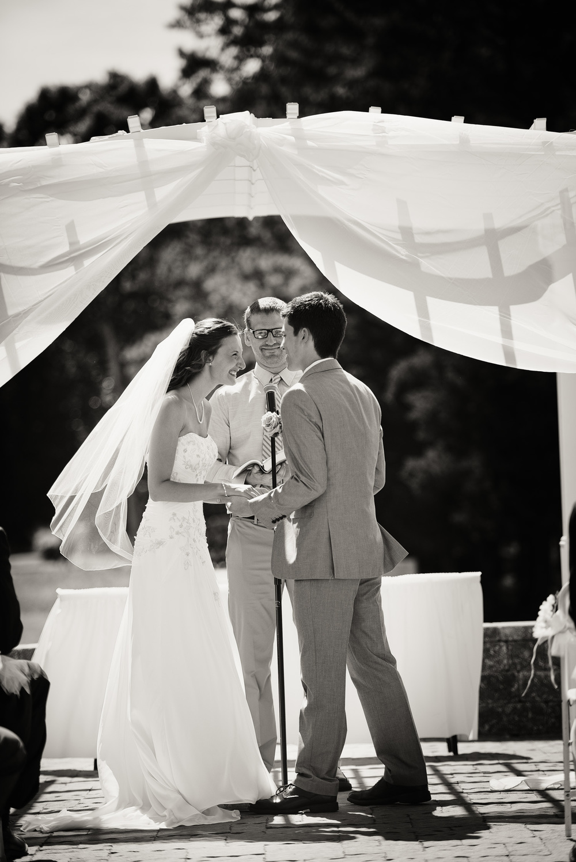 groom bride sunshine daytime wedding ceremony first kiss laughter husband joy wife bw portrait THPHOTO