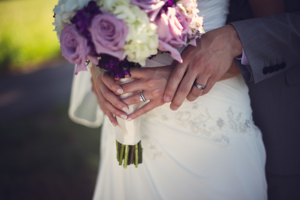bands rings daytime wedding bride groom husband wife hands bouquet flowers THPHOTO
