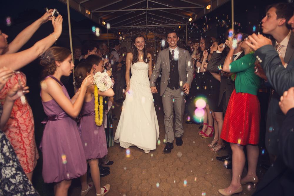 wedding reception exit send off bride groom runway bubbles night
