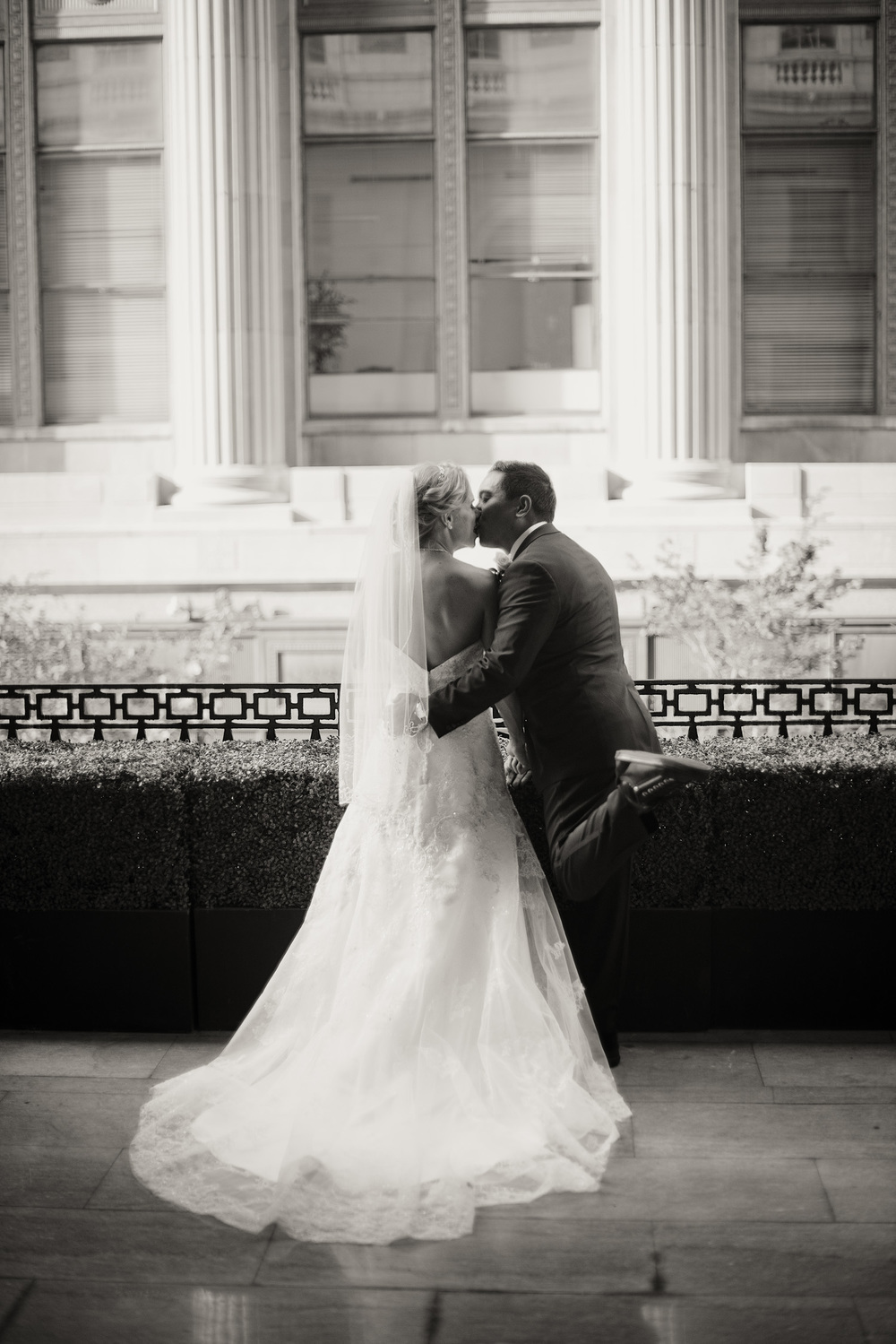 Bride and Groom kiss bw Ballroom at the Ben Philadelphia PA THPHOTO