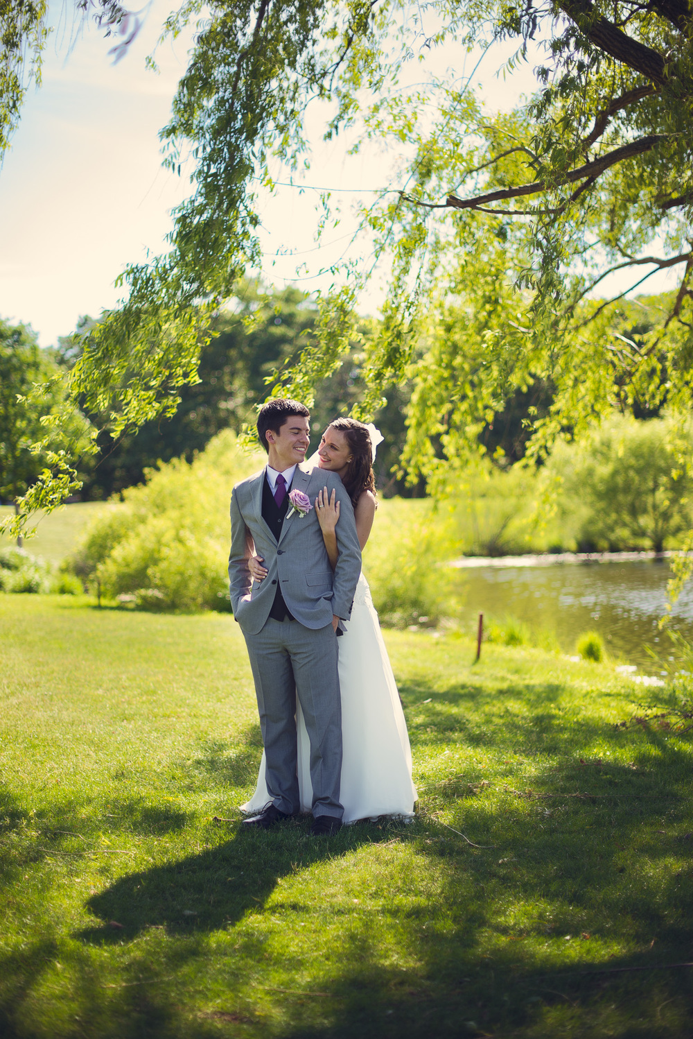 Bride and Groom beneath tree at the Blue Heron Pines Golf Club THPHOTO