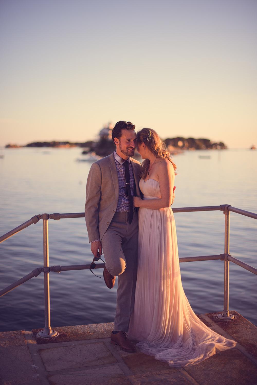 Bride hugs groom in front of ocean Branford, CT THPHOTO