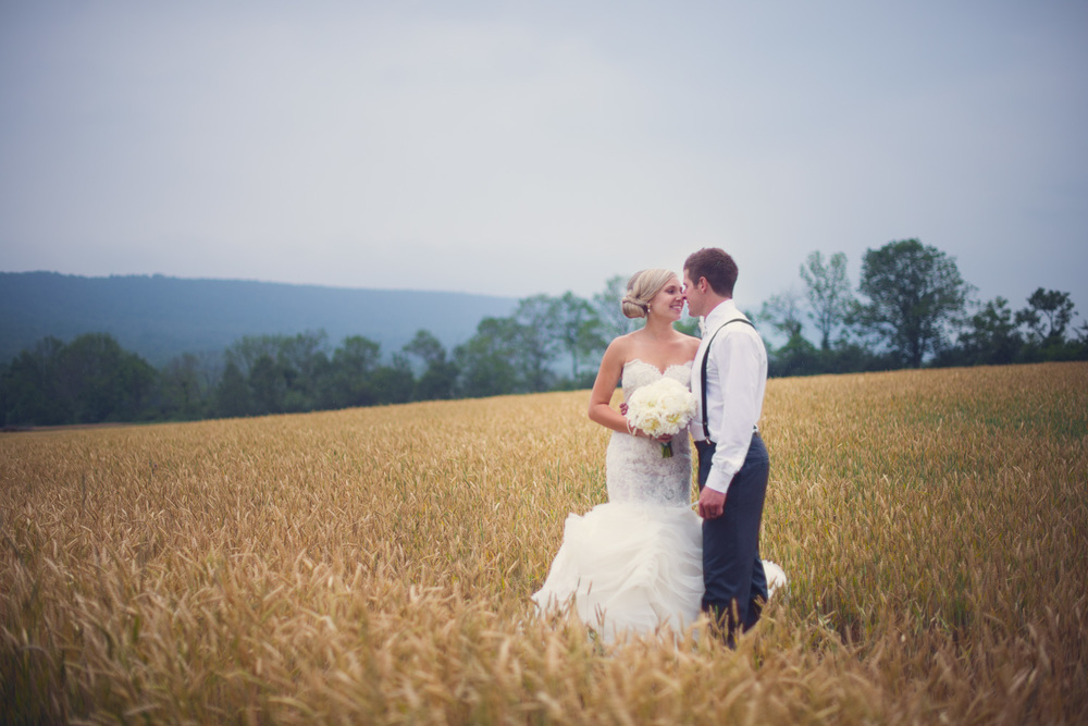 Bride and Groom smile in field Jonestown, PA THPHOTO