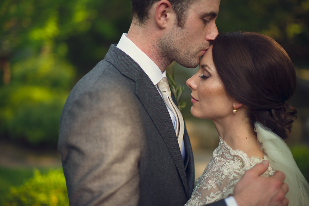 Groom kiss brides forehead Holly Hedge Estate New Hope PA THPHOTO