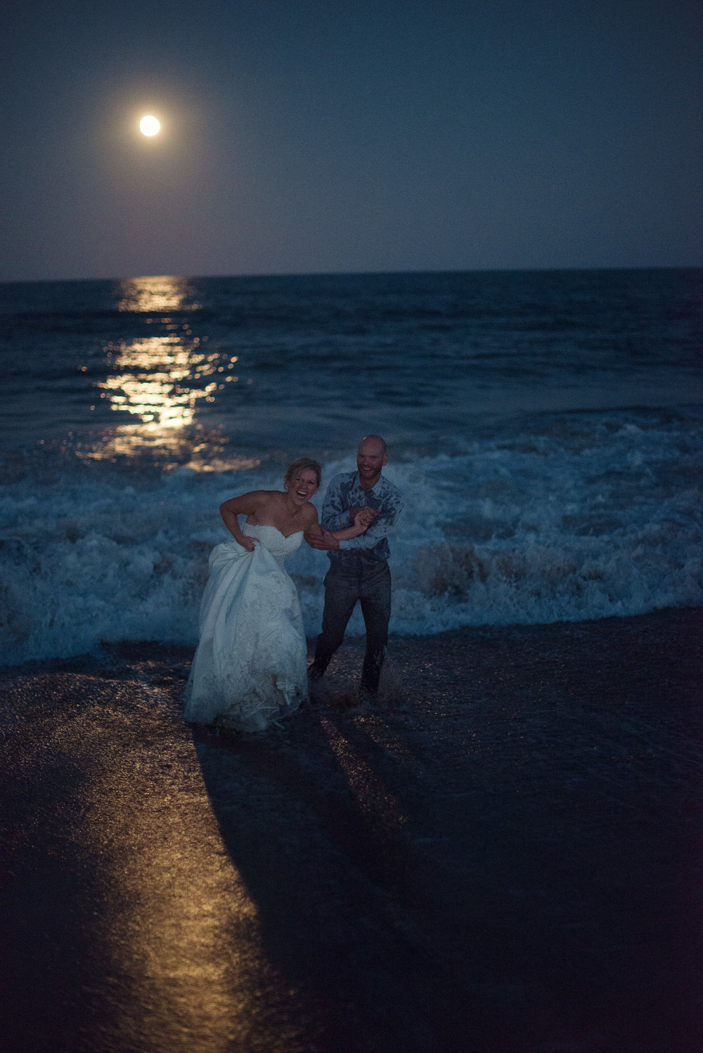 Wedding couple swim night moonlight sand shore beach ocean delaware THPHOTO