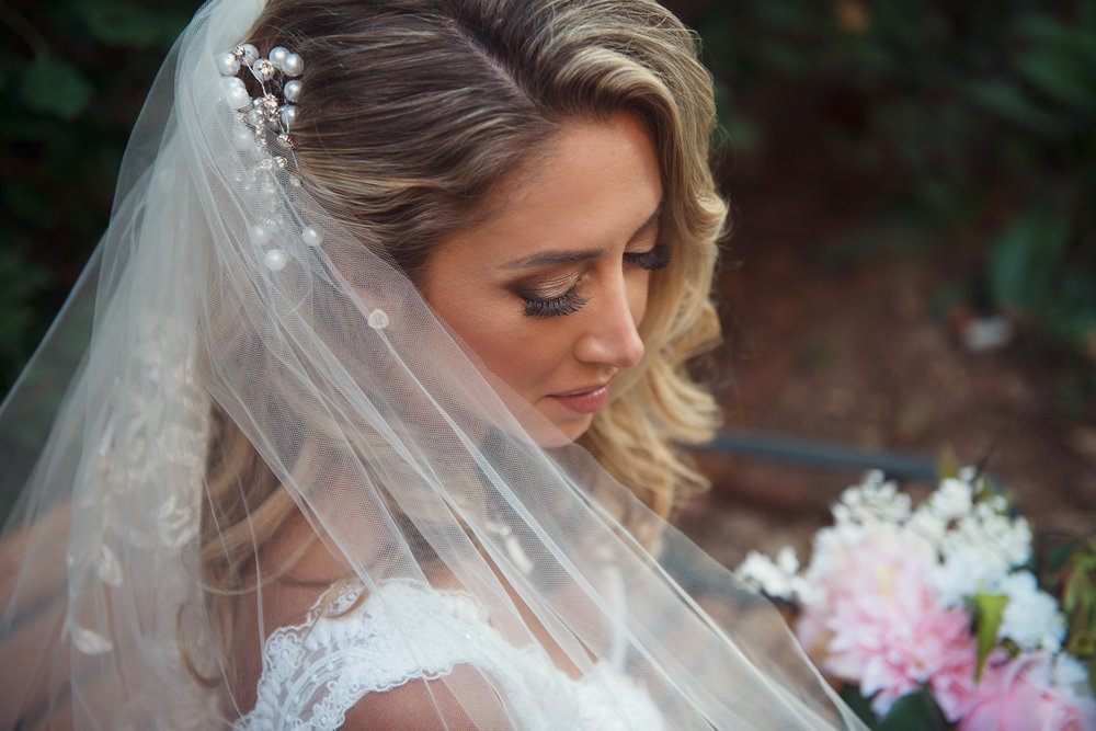 Blonde Bride looking down with veil Alisha Nycole Makeup in Bethlehem PA Lehigh Valley THPHOTO
