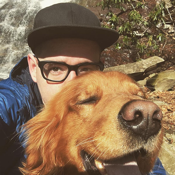 Co-pilot, Chuck; I enjoy my puppies and climbing --->
