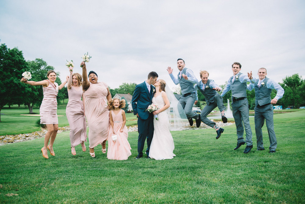 wedding bride groom husband wife couple married love bridal party jump silly laughter