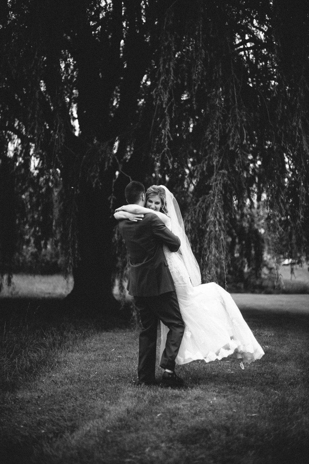 wedding bride groom husband wife couple married love bw hug spin
