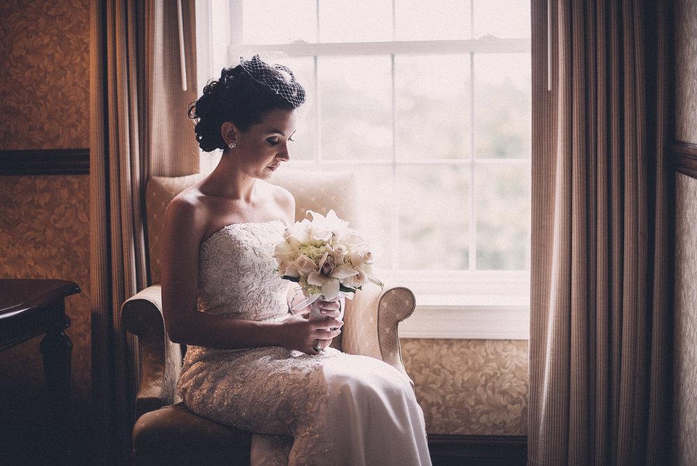 Bride sitting bird cage veil bw Manor Hotel West Orange, NJ THPHOTO