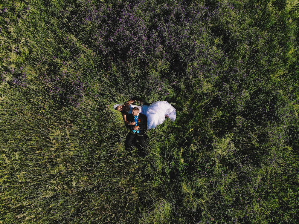 drone MavicAir above portrait wedding couple bride groom flowers