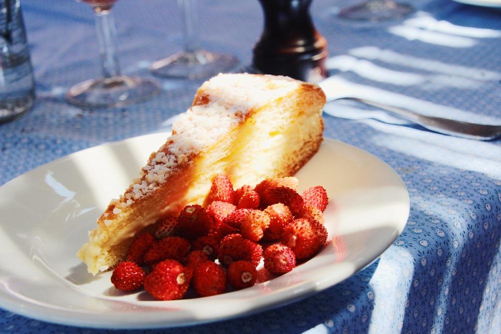 Delicious vanilla layered cake. Mini strawberries on the side!