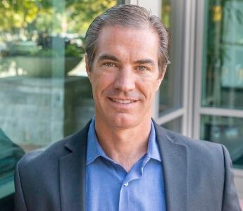 Mark Casey  CEO,  Apcela