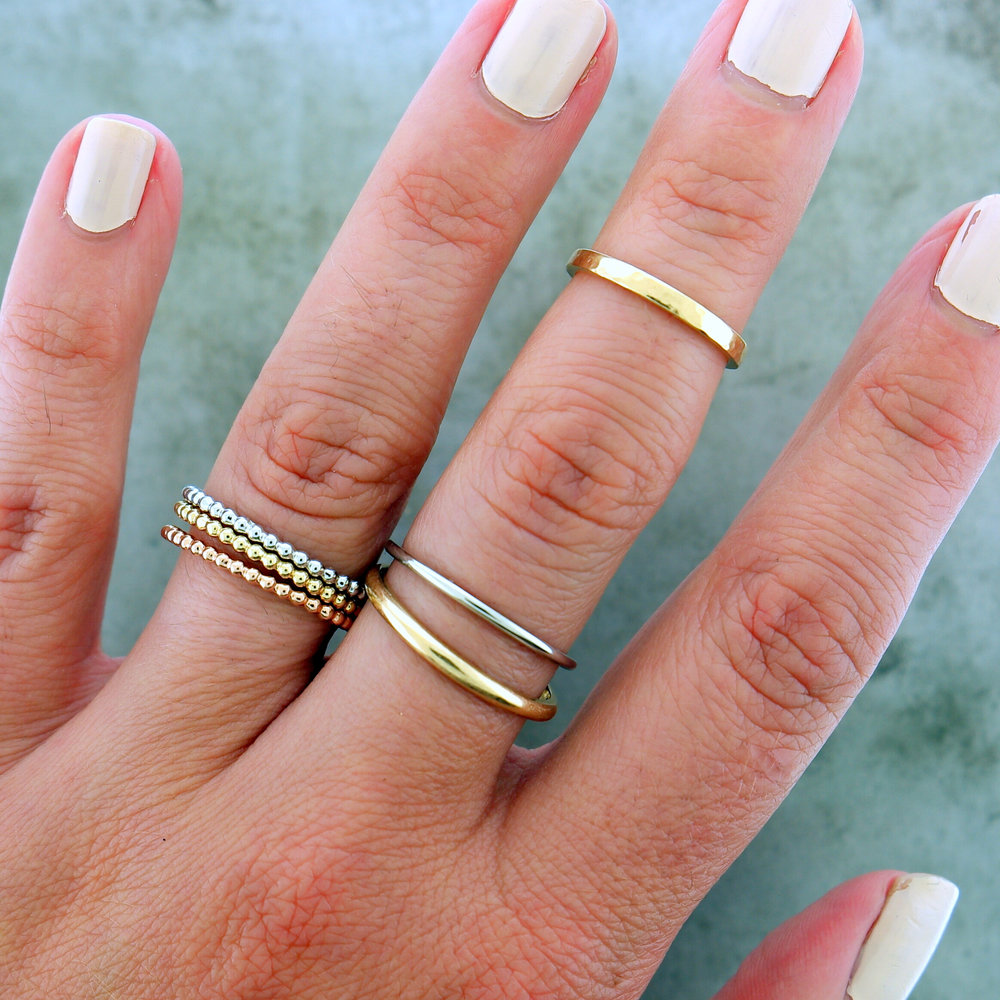 "Ring Stack featuring ""Threes Company"", ""Get Hammered"", ""Stay Gold"" & ""Ultra Slim"""