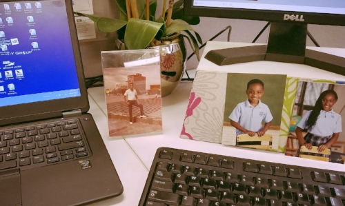 My desk At work with pictures of my dad and kids