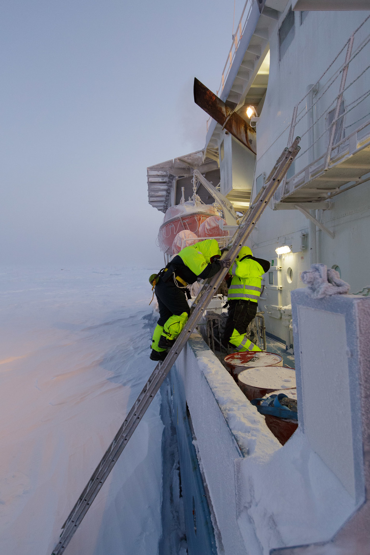 Crewmembers disembark Lance