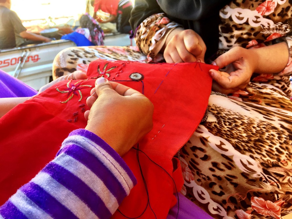 Bedouin women embroidering crafts