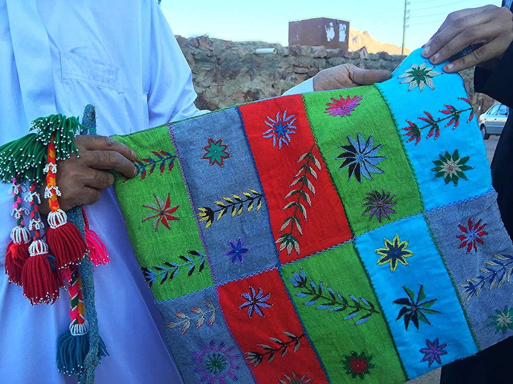 Handing over a Bedouin Craft cushion cover
