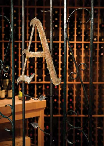 Personalize your wine cellar with items that are meaningful to you and your family. For this Kirkland cellar, Randy Altig installed a salvaged iron gate and fitted it with a custom monogram. He chose mahogany wine racks from Wine Enthusiast (wine enthusiast.com) and a Boos butcher-block table from the Butcher Block Company (butcherblockco.com).