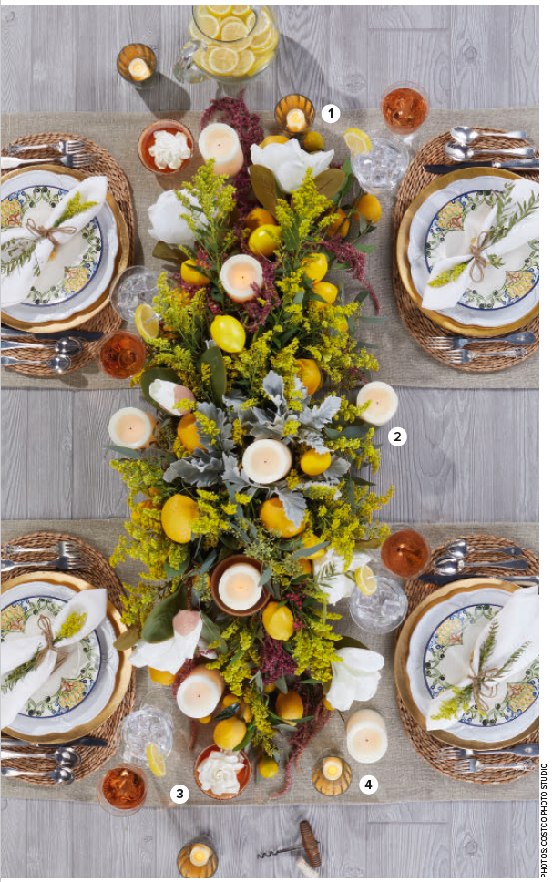 For the arrangement shown above, I created a base with a wooden bread trough (traditionally used for kneading dough) to blend the visual weight of the table with the centerpiece while staying true to form for a tablescape on a rectangular table.  Pick colors and textures that evoke your overall theme. I recommend no more than four colors plus an accent; remember that sometimes less is more. To accomplish this I chose citrus yellow, green-blue, green-gray and cream. My accent was blush rose pink.