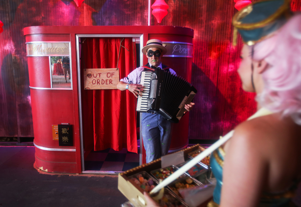 "Mr. Charley, an accordion-playing mime, allows festival goers access into what looks like an out-of-order photo booth but in fact, is a passage way to The Poetry Brothel, providing one-on-one readings in multiple back rooms in The Hangar, a new stage at Electric Forest on Thursday, June 25, 2015. Poets as ""whores,"" each operate within a carefully constructed character, who impart their work in group readings, spontaneous eruptions of poetry, and most distinctly, private, one-on-one poetry readings. The festival at Double JJ Ranch in Rothbury Mich. continued through June 28."
