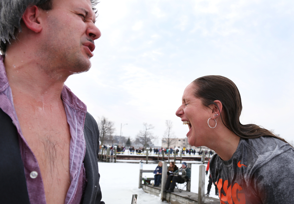 Polar Plunge participants react after jumping into Muskegon Lake during Muskegon's Polar Plunge on Feb. 7, 2015. Two hundred and eighty-nine people took a dip in Muskegon Lake to raise $63,868 for Special Olympics Michigan. The temperature was in the 30s and the water was ice cold.
