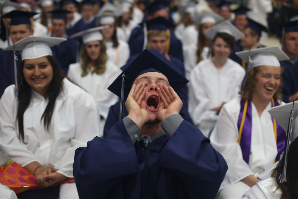 Sebastyn Brown cheers on a friend as he receives his diploma during the Fruitport High School's Graduation ceremony at L.C. Walker Arena Friday, May, 29, 2015.
