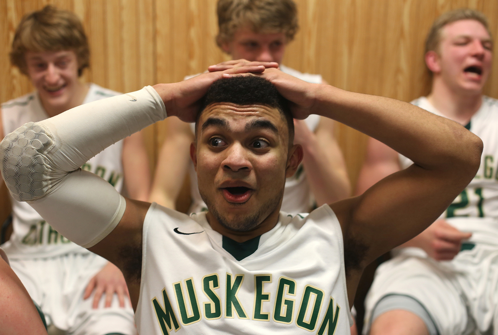 Lamar Jordan of Muskegon Catholic Central reacts in the locker room after defeating Spring Lake in the last few seconds of the game at Muskegon Catholic Central High School Thursday, March 5, 2015. MCC won the Lakes 8 Conference title with a score of 50-49.
