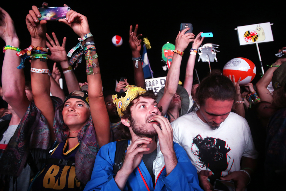 Festival goers react during Bassnectar's opening performance at the Ranch Arena in Electric Forest on Saturday, June 27, 2015.