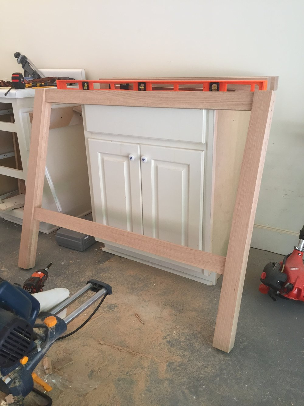 This is the start of the vanity. After looking through tons of vanity options, Charlie decided that building it himself was clearly the cheapest option, and the best way to get what we were looking for. So thankful he was up for the task:)