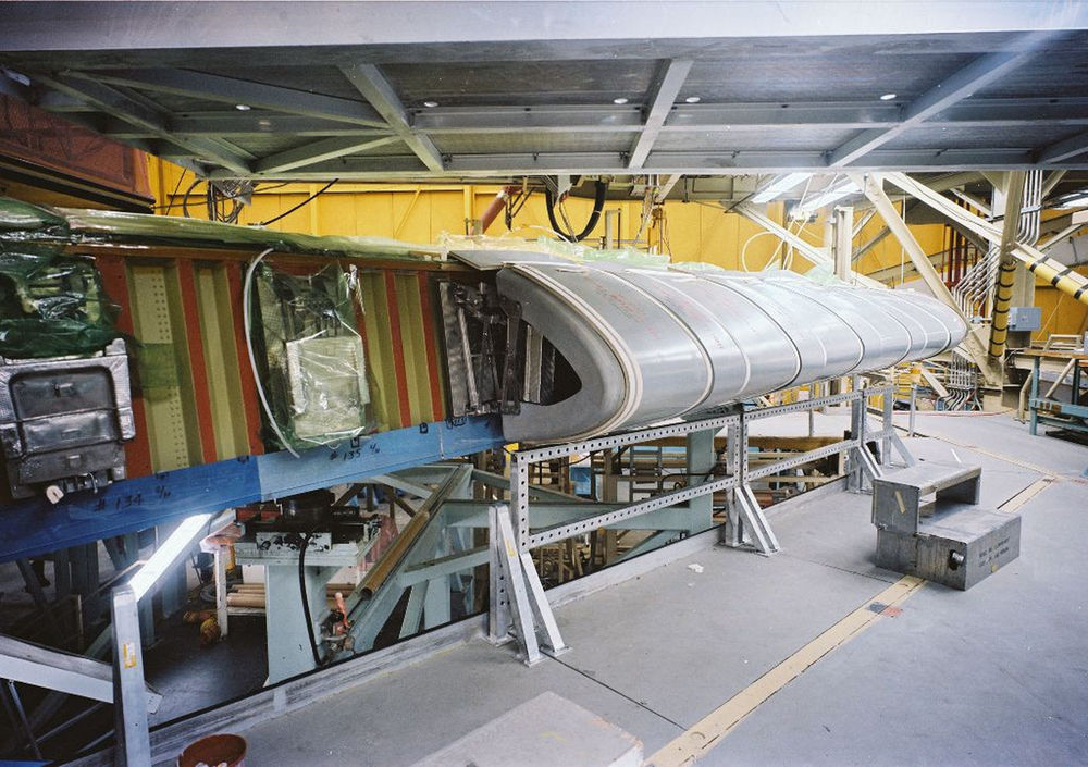 nstallation of a panel on Atlantis' left wing continues at Rockwell's Palmdale plant on Oct. 26, 1982..jpg