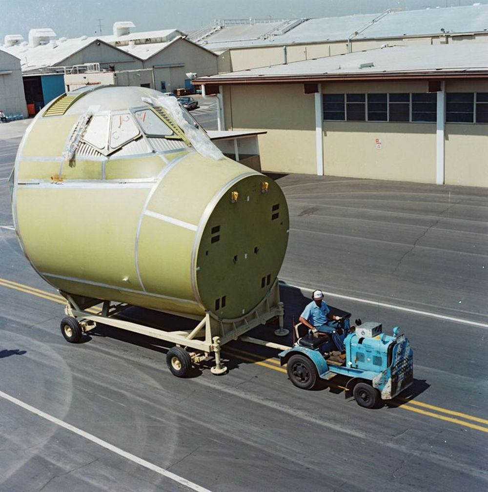 Shuttle Atlantis' crew module is transported to Rockwell's vacuum chamber test cell, at the Downey facility on March 31, 1983..jpg