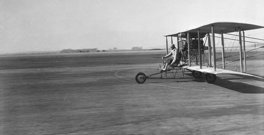 Early style pusher airplane at Mines Field, Los Angeles, ca. 1931