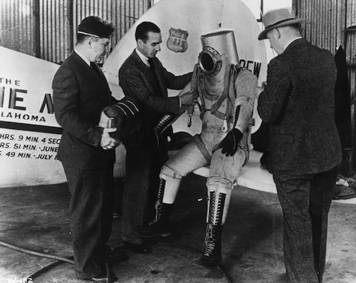 Post Suit Wiley Post, Bill Parker, and Capt. Balderston (left to right) conferring with an unidentified pilot wearing the sub-stratosphere suit, 1935.
