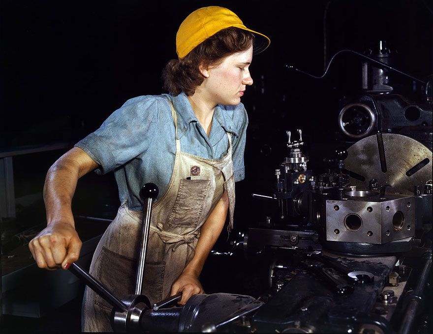 October 1942. Lathe operator machining parts for transport planes
