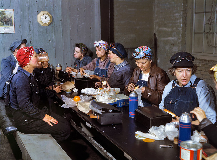 Women employed as roundhouse wipers having lunch,