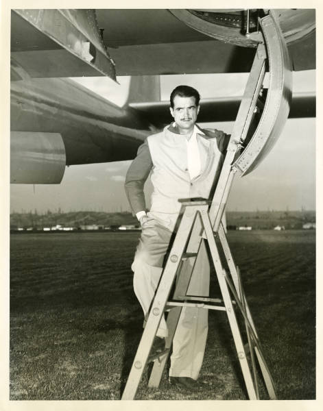 Photograph of Howard Hughes underneath the XF-11 plane, April 3, 1947