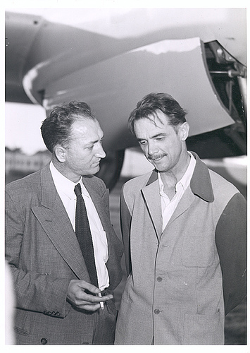 Photograph of Howard Hughes with unidentified man beside the second XF-11, April 4, 1947