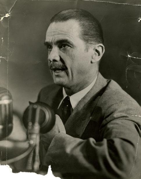 Howard Hughes speaks into a microphone as he testifies before the Senate War Investigating Committee, August 6, 1947, in Washington, D.C..jpg