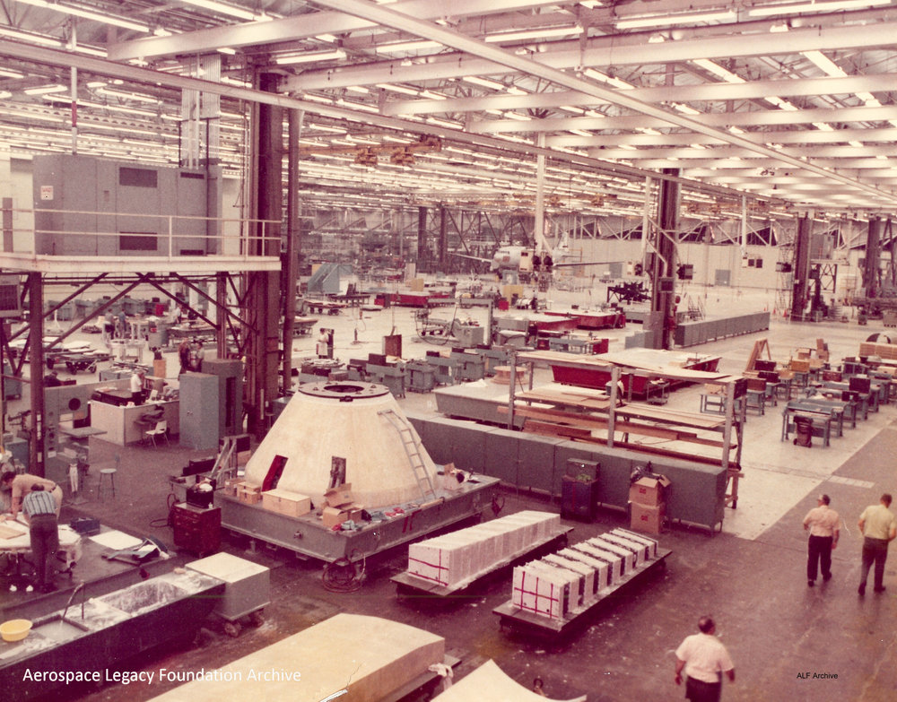 North American Aviation Apollo work in building 1 workers and spaceships marked 1-4 labeled.jpg