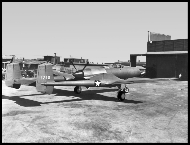 "Vultee XP-54 (Convair N17638, SDASM, 03617). Photo is at Vultee plant in Downey California. This is shot near the former ""gate 19"" at Rockwell and at the iconic ""Vultee sign and 90 degree support below it. Image- SDASM"